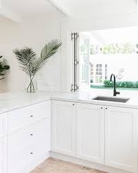 white kitchen cupboards black bench 12 white kitchen cabinets black hinges and hardware ideas
