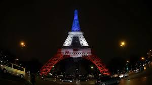 vive la world landmarks light up in white and blue in