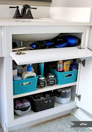 How To Organize Under Your Bathroom Sink - under the sink organization bathroom and kitchen organizing tips