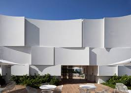 the new dior shop in miami is shining in curved panels designed by