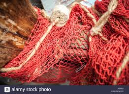 closeup shot of natural fiber net on old wooden boat stock photo