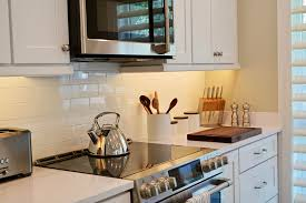 white shaker kitchen cabinets backsplash illuminating your kitchen for a brighter more open space