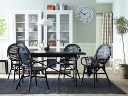 choice dining gallery dining ikea a dining room with a black dining table and rattan chairs combined with two white
