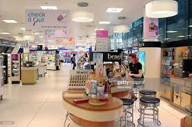 boots shop a shop assistant works at the cosmetics counter at a boots s