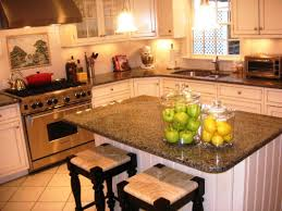 dark granite countertops with white kitchen cabinets team