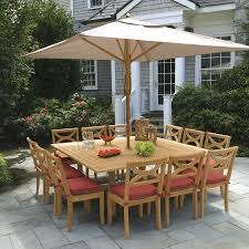 square outdoor dining table carmadelia outdoor dining set w swivel chairs and umbrella table