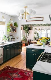 white kitchen cabinets with green countertops 25 chic and lively green kitchens shelterness