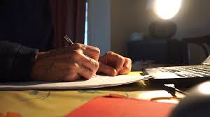Office Desk Close Up Close Up Of Elderly Man Hand Writing Letter At Night By Home