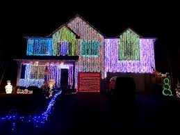 christmas light display synchronized to music clark griswold could learn a few things from these holiday light
