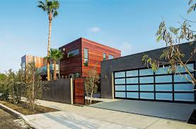 wooden wall exterior home design with grey garage using white door