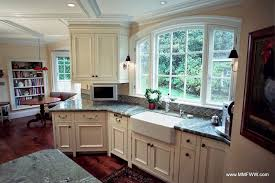 painted and stained kitchen cabinets custom kitchen cabinets with a mix of painted and stained cabinets