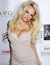 cutting hair so it curves under pamela anderson struggles to contain her famous curves in a very