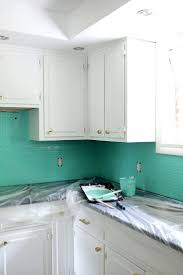 can laminate kitchen cabinets be painted tile over laminate backsplash gray wall tiles can you paint over