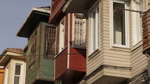 Bay Window Awnings Window Awnings Are Blown In The Wind On A Residential House On A