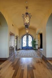 mediterranean entryway with barrel vaulted ceiling by milestone