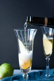 holiday champagne cocktails spiced pear bellini golden autumn day hungry by nature