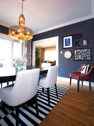 a dining room with blue suede walls features a black and white