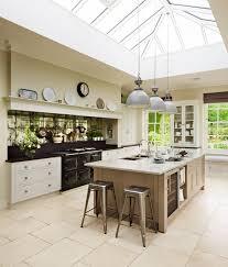 bespoke martin moore kitchen with antiqued mirror glass splashback