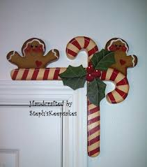 hand painted gingerbread and candy canes door huggers 15 95 via