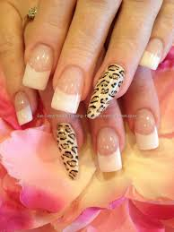 white acrylic tips with cream black and gold leopard freehand