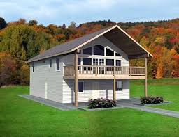 cabin plans with garage this large two stall garage provides living space with a two