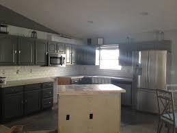 modern kitchen white cabinets with dark granite black drawer