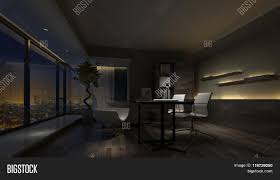 darkened dimly lit empty interior of a home office at night with a