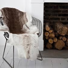 Reindeer Hide Rug The Modern Sophisticate Get Cozy Reindeer Hide Rugs
