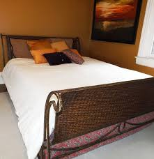 Ralph Lauren Furniture Beds by Wicker And Iron Sleigh Bed With Linens And Ralph Lauren Pillows Ebth