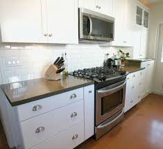 white glass subway tile kitchen backsplash the traditional but look from subway tiles kitchen cement patio