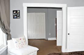 louvered interior doors decorating wooden folding closet doors on tan wall and ceramics