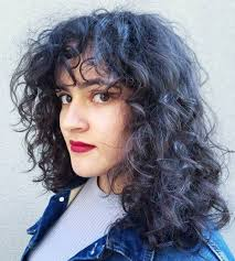 hairstyles for curly and messy hair 40 cute styles featuring curly hair with bangs