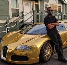 gold and white bugatti actor jamie foxx u0027s bugatti veyron gets gold wrap motoroids