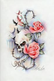 feminine skull roses right fore arm with words for good and evil