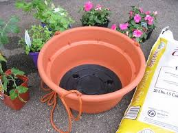 Upside Down Tomato Planter by How To Make An Upside Down Tomato Planter Curbly