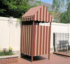 backyard with white fences and stripes portable shower enclosure