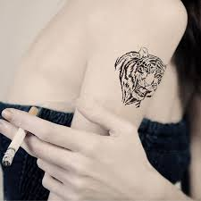 small tiger on bicep tiger tatoo tiger