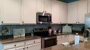 white brick mother of pearl shell tile kitchen backsplash subway