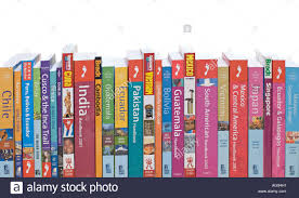 travel books images Selection of travel guide books to various destinations on a shelf jpg