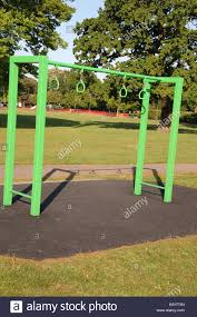 climbing frames and slides at children u0027s play ground in roe green