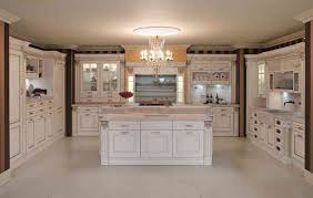 classic and antique white kitchen cabinets design with chandelier