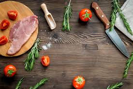 meat cutting table tops meat for steak with rosemary and tomato on table top view mockup