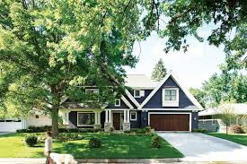 tan and blue color scheme exterior traditional with stone pillar