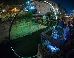 waller creek light show east side collective has constructed a glowing arch in austin texas