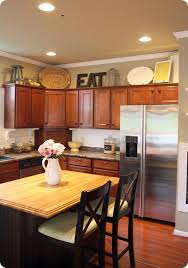 Above Kitchen Cabinet Decorations How To Decorate Above Kitchen Cabinets From Thrifty Decor