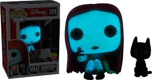 the nightmare before sally seated with cat glow in the