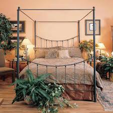 decorate a half wrought iron canopy bed modern wall sconces and