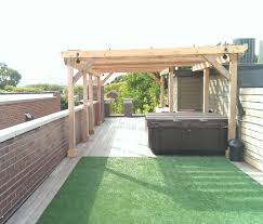 intrinsic landscaping the earth is our business to design and build custom roof decks on the roof of the main building as well as the roof of the garage features include custom overhead structures