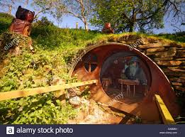 hobbit house stock photos images alamy the hobbit house exhibit with wizard gandalf inside carnglaze caverns tourist attraction