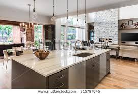 kitchen island sink kitchen island sink cabinets hardwood floors stock photo 315797645
